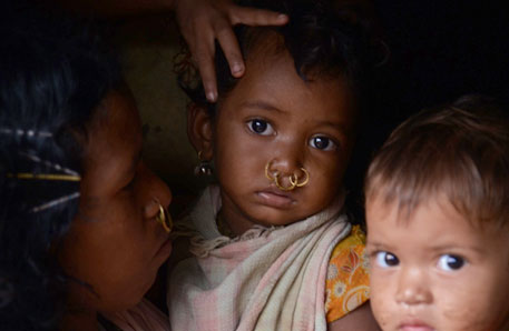 A Dongria Kondh girl from Kadraguma village in Rayagada district reacts to the camera