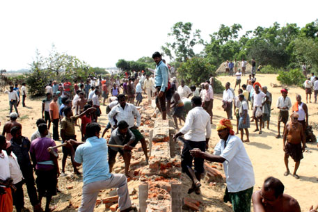 Agitated people dismantle POSCO's boundary wall, torch office