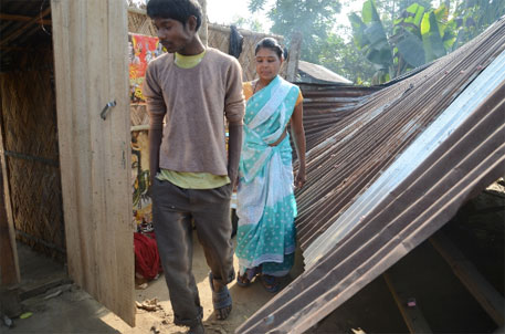 Lalita Lohar with her son in her home damaged by an elephant; for days the house won't be repaired in the faint hope of compensation (Photos: Sayantan Bera)