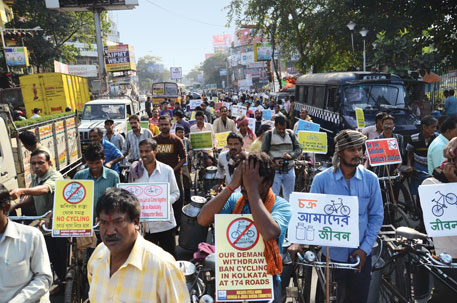 Cyclists protest the ban in Kolkata, the only metro where road trips on cycles outnumber trips made by cars