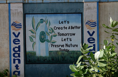 Writing on the walls of the Vedanta refinery in Lanjigarh. Proposed bauxite mining in 660 ha will wipe out much of the 721 ha of forests in the Niyamgiri, the source of sustenance of the Dongria Kondh and other forest dwellers.