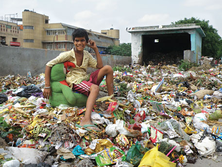 Saleem, 11, collects only plastic waste. Each member of his family of ragpickers picks a different kind of waste