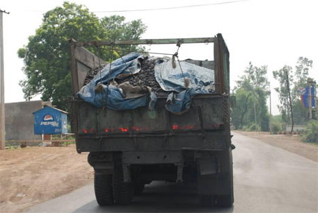 Coal truck along a Chhattisgarh highway, a common sight