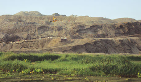 The out-of-place grey hillocks in Rourkela are mounds of steel slag dumped by a SAIL plant