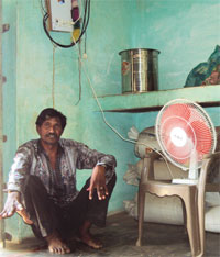 Dungar Singh finds using a fan expensive; solar panels installed at the roof of a school in Neechli Babhan