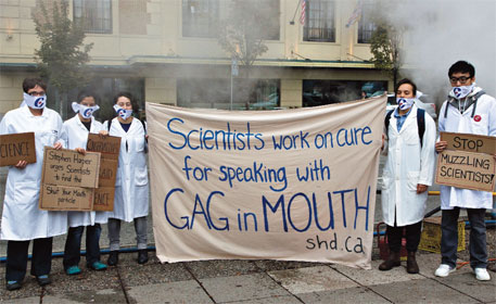 Protesters dressed as scientists demonstrate in Vancouver against the government's science policy