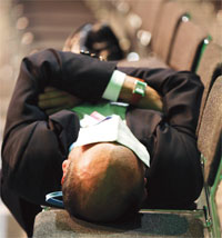 A delegate takes a nap on the last day of negotiations