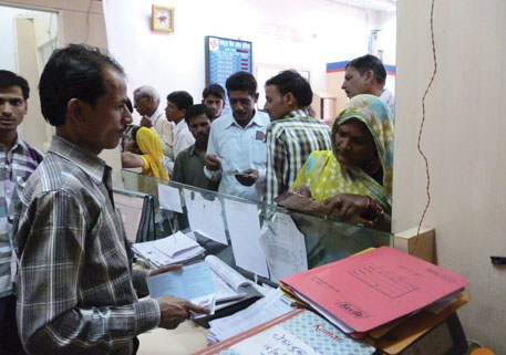 People of Parsoria village in Madhya Pradesh queue up at the bank for transactions