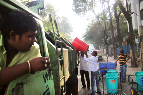 'Ghanta (bell) trucks' transport most of the wet waste generated by the city