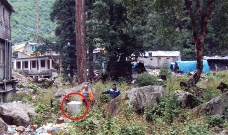 Forest officials have installed pillars (circled) to mark boundary of forestland