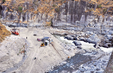 The river has narrowed down and changed its course as repair work is being done for the Dhauliganga power project in Elagad, Dharchula