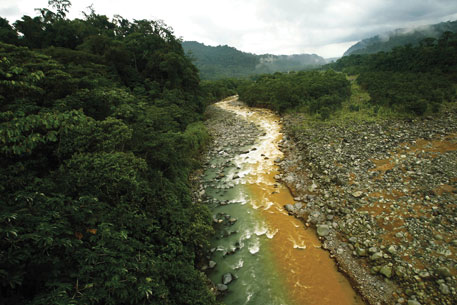A branch of the Rio Sucio (or Dirty River) carrying volcanic minerals and mixing with clear water filtered by rainforest in San Jose
