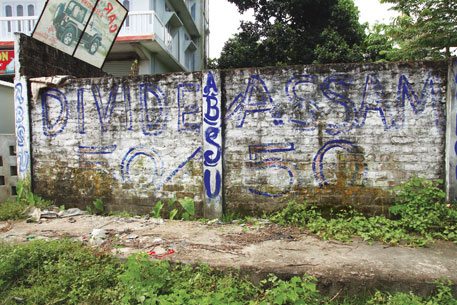 "Slogans like ""Divide Assam 50-50"" are a common sight on the streets of Kokrajhar district"