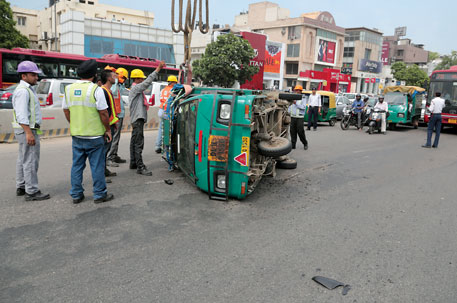 A speeding car hits and overturns a tempo on a Delhi road. About 6 per cent road deaths involve people travelling in tempos and vans