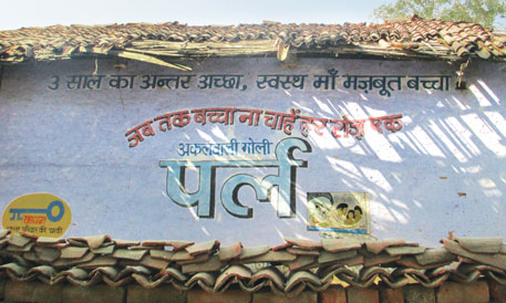 Although contraceptive pills are advertised on house walls in Lokhandi village, few women are aware of these options