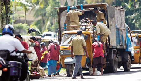 Women working for Kudambasree units have to buy autorickshaws to carry waste on loan