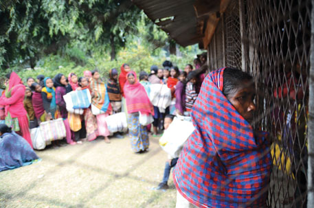 Tea garden workers at Redbank queue up for food relief disbursed under a special scheme for closed gardens