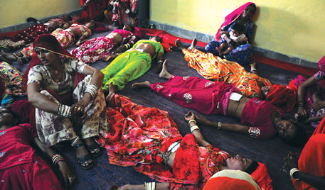 Unconscious women lie on the floor after undergoing sterilisation operation at a community health centre in Kolayat block in Bikane