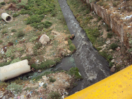 Waste flowing into the Assi river, a tributary of Ganga, which has been turned into a drain