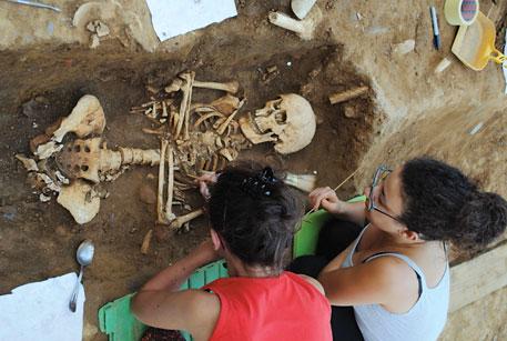 Students excavate human remains buried in the post-medieval churchyard at Badia Pozzeveri in Tuscany, Italy