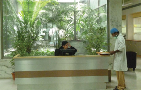 An open courtyard outside the hospital's OPD reduces need for artificial lights