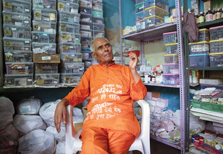 One room of Sharma's modest two-room rented house is full of tall medicine racks