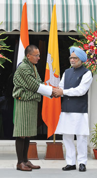 Bhutan's Prime Minister L T Tobgay (left) paid a visit to his Indian counterpart Manmohan Singh after winning elections