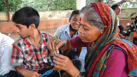 A woman practising grafting   technique during a workshop to promote local mango varieties in Urawade village, Maharashtra (Source:CEE)