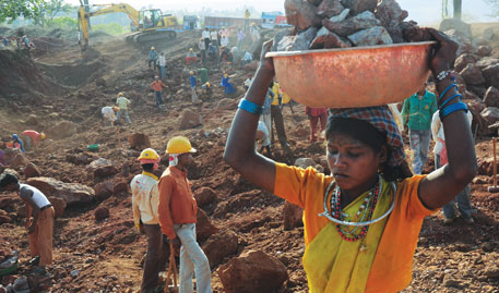 A displaced Baiga woman works as a daily wager in Vedanta's bauxite mine