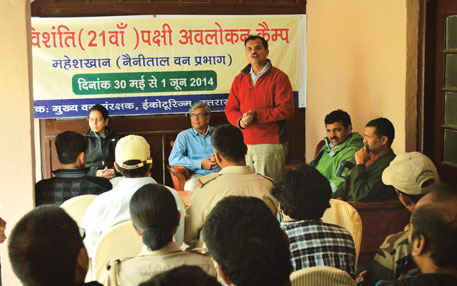 Forest officer Rajiv Bhartari addresses participants at the camp