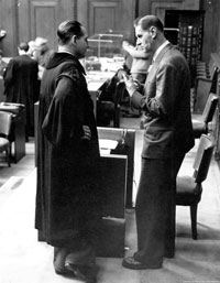 Fritz ter Meer (right), defendant of the IG Farben trial at Nurnberg, chats with his counsel during a court intermission