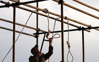 An Iranian soldier prepares for public hanging. Will videos of such executions help deter crime or desensitise viewers?
