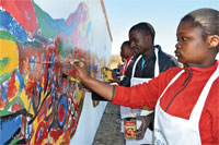 Students of High School for the Deaf paint a mural