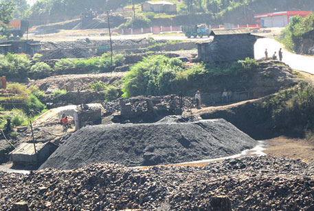 A thin stream of water leaches from a mound of coal excavated along the National Highway No. 44. A unique feature of the coal found in this region is that it is rich in sulphur. On contact with water, the sulphur in the coal reacts to form acids. With high rainfall, acid mine drainage is a serious problem in the state  (Photographs by Monali Zeya Hazra)