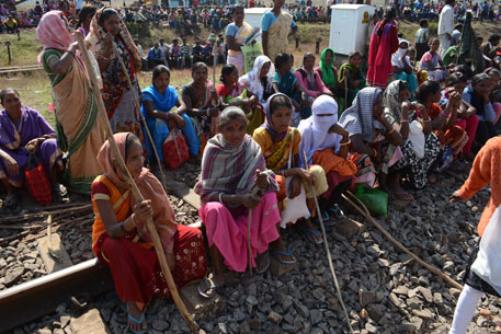Tribals stage sit-in at Kukura railway gate, blocking a goods train on the Mumbai-Howrah line (Photo: Uttam Kumar Pal)