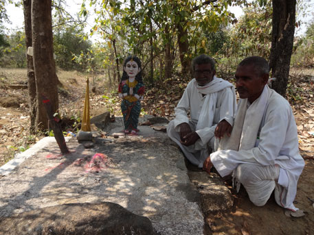 Kewalram Tondre (right) and other tribl elders worship at a tribal shrine in the Shankarpur CFR forest.