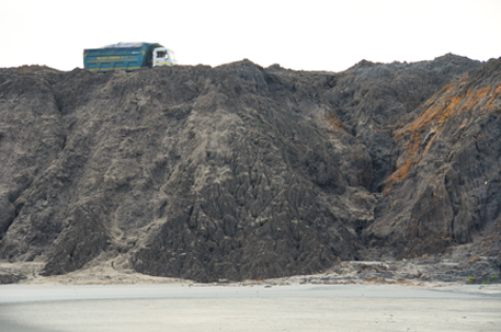 Company truck continues to dump more fly ash at the site
