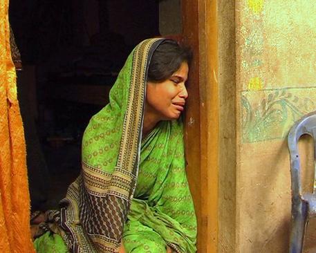 Khema, widow of Manad Jena, cries over her loss