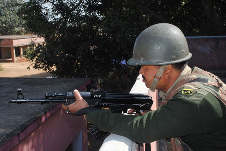 Tripura state rifle jawan keeps vigil on a forest from a government school at Lohardaga