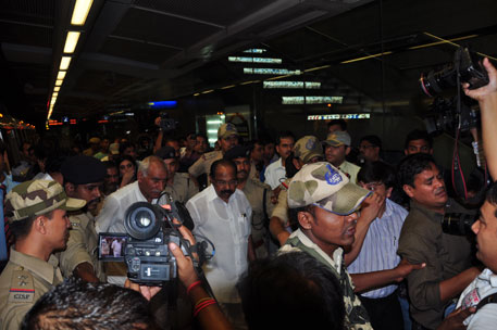 Union Minister for Petroleum and Natural Gas, Veerappa Moily arrives at Race Course Metro Station flanked by security and   media personnel on Wednesday as his plan to Save fuel. Photo: Ruchita Bansal/Centre for Science and Environment