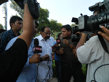 Union Minister for Petroleum and Natural Gas, Veerappa Moily on his way to Race Course Metro Station surrounded by media channels seeking bytes as soon as he emerged from his house on Wednesday. Photo: Anupam Chakravartty