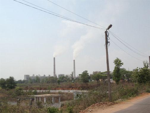 Chimneys spew smoke in Korba city