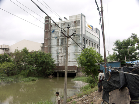 A hotel built illegally on stilts on the Ganga cherevu