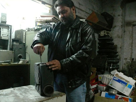 Sabir's licence for a collection agency allows him to collect and sell e-waste to formal recyclers