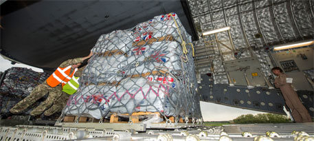 An RAF C17 aircraft is loaded with aid from British people for the earthquake-affected victims of Nepal (Photo: DFID/Flickr)
