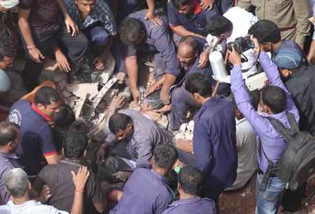 National Disaster Response Force and fire department Officials from Vadodara carry out rescue operations