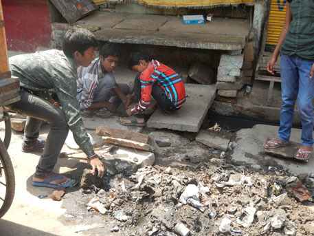 Across Varanasi, gutters overflow with plastic and garbage