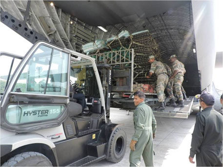 Engineering equipment being loaded onto an airplane in India to help with rescue operations in Nepal (Indian army's Facebook page)