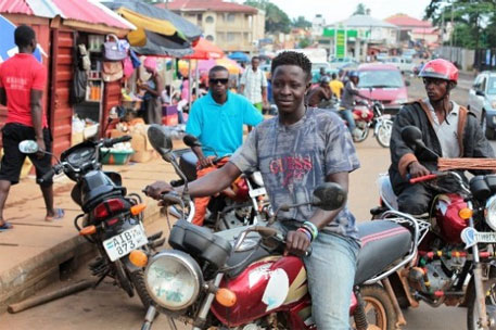 Bike riders reach out to people in a unique campaign against Ebola