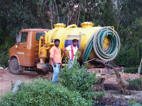 A honey-sucker truck dumps excreta inside a pit in a farmland in Bengaluru. Septage removed from septic tanks are dumped in open areas or water ways in Indian cities